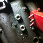 adapters in the spark plug holes